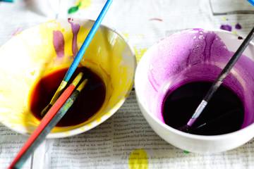 Paintbrush on painted bowl