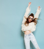 portrait of cheerful fashion hipster girl going crazy making