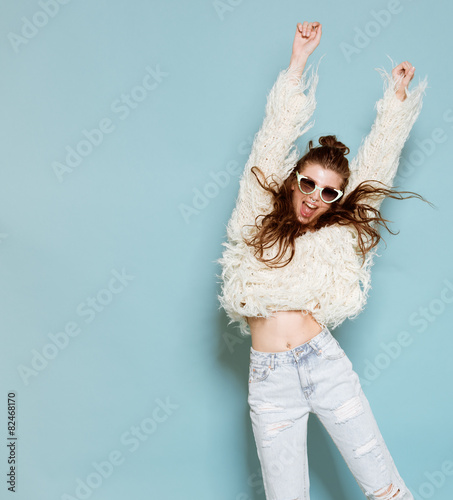 portrait of cheerful fashion hipster girl going crazy making - 82468170