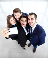 People taking selfie at business meeting