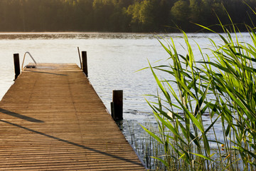 Lake and pier at summer morning
