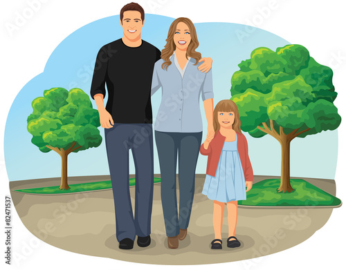 Smiling young family walking hand in hand in the park - 82471537