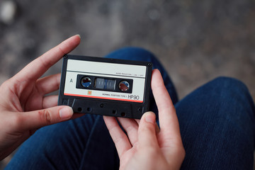 Beautiful girl with a cassette in her hands