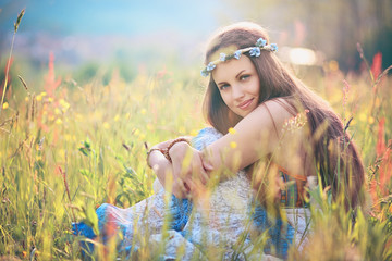 Beautiful romantic woman in flower field