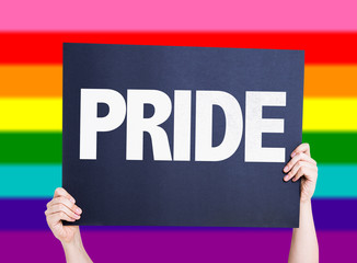 Pride card with rainbow flag on background