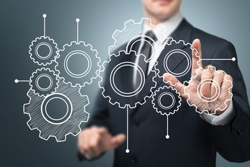 Business. Businessman hand touch blue  gear to success concept