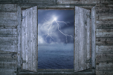 Thunderbolt and wooden window