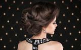 Hairstyle. Brunette woman with wavy retro hair styling. Fashion
