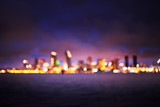 blurred out of focus bokeh-scape of san diego skyline at night