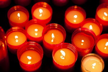 Red candles inside church