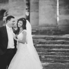 Black and white picture of young wedding couple together.