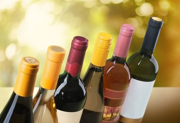 Wine Bottle. Wine bottles in a row on white horizontal