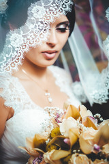 Portrait of the bride with a veil. Wedding theme.