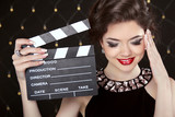 Fashion elegant woman posing with sexy red lips holding cinema c