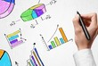 Document. Business person drawing colorful graphs and icons on