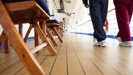 Pan of Senior Couple Taking a Walk on Deck of Luxury Cruise Ship