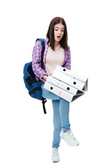 Young woman with backpack and folders
