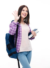 Happy young woman making greeting gesture with palm