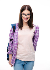 Happy young female student looking at camera