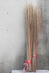 Coconut broom stick on brick wall