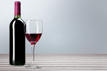 Wine Bottle. Red wine bottle and glass, isolated on white