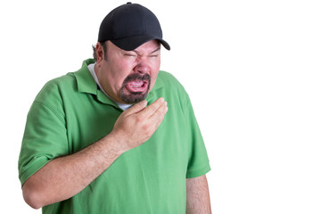 Man Wearing Green Shirt Sneezing