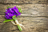 Fototapety Beautiful bouquet of violets on the wooden background