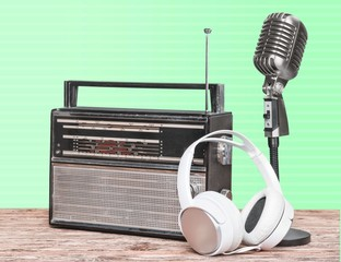Broadcasting. Retro radio and cassette player, microphone
