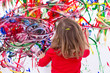 Young Kid Painting Abstract on White Wall - 82495528