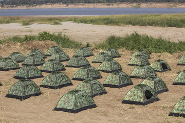 group of army tent at riverside