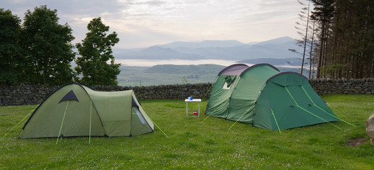 Tents with view over estuary to Snowdonia mountains Wales, UK.