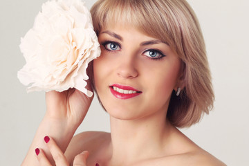 beautiful blond model with a flower