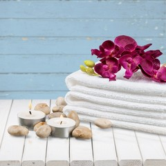 Spa Treatment. Gladiola, towel, candles and river stones