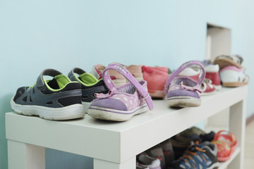 White shoe shelf with children shoes