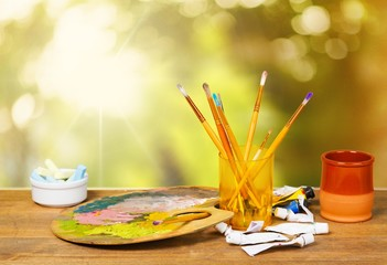 Craft. Artistic equipment: paint, brushes and art palette