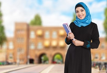 Arab. Happy saudi Arab student holding folders isolated on a