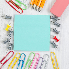 Close up of School Supplies on White Wood