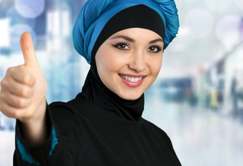 Aba-ya. Arabic business woman,smiling and showing a thumb up
