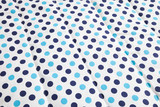 light blue and dark blue polka dotted quilt