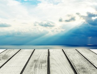 Background. Wood, blue sea and sky background