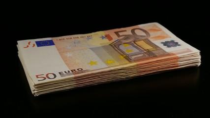 Stack of 50 euro bills turning