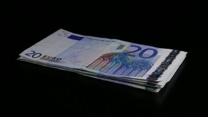 Stack of 20 euro bills turning