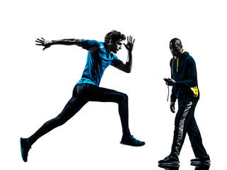 man runner sprinter with coach  stopwatch silhouette