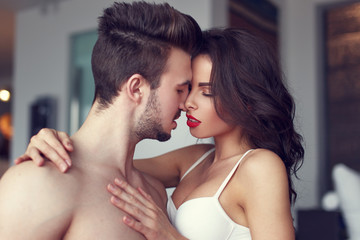 Sexy passionate couple foreplay