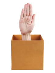 Human hand protruding from a box