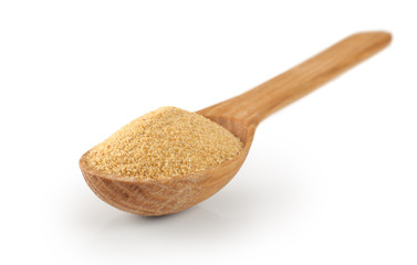Wooden spoon with dried garlic.