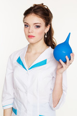 Young pretty girl nurse with blue squirt in hands