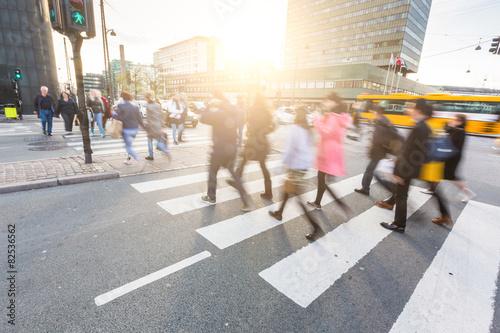 Poster Blurred crowd of people walking on zebra crossin in Copenhagen