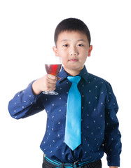 Happy boy with glass of soft drink in hand isolated on white bac