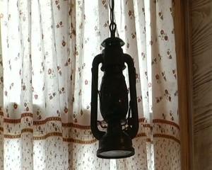 Antique lantern in a modern cafe interior